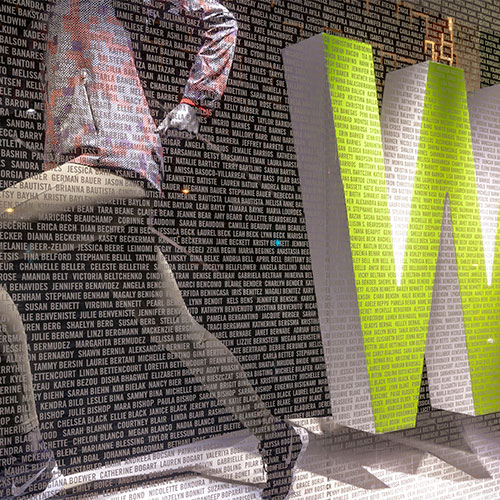 Image of a window display with thousands of names applied to the window in cut vinyl