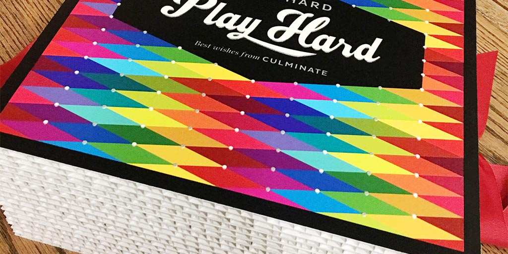 Image of a colorful graphic on top of a box made of corrugated cardboard