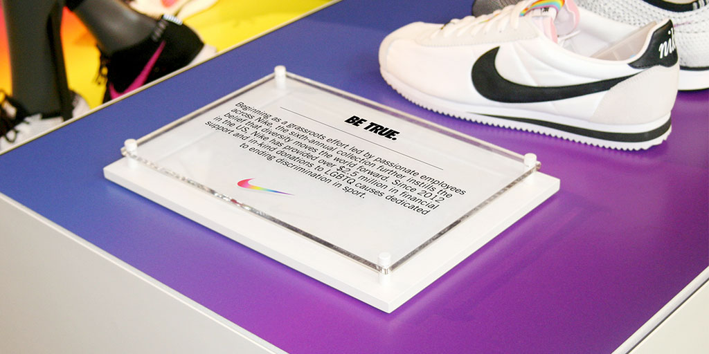 Image of shoe display with printed clear acrylic sign