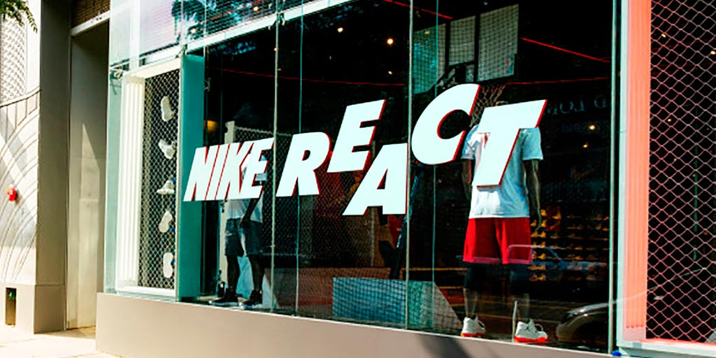 Image of a window with large cut vinyl words displayed on them