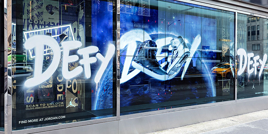"Image of cut vinyl spray ""spray paint"" applied to a retail window"