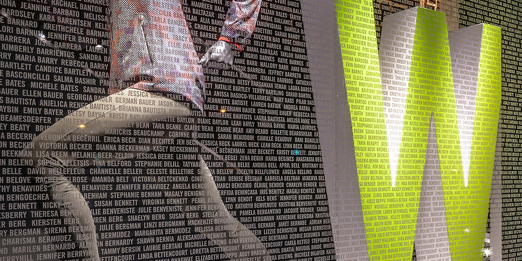 Image of a retail window covered in cut vinyl of race participants' namesq