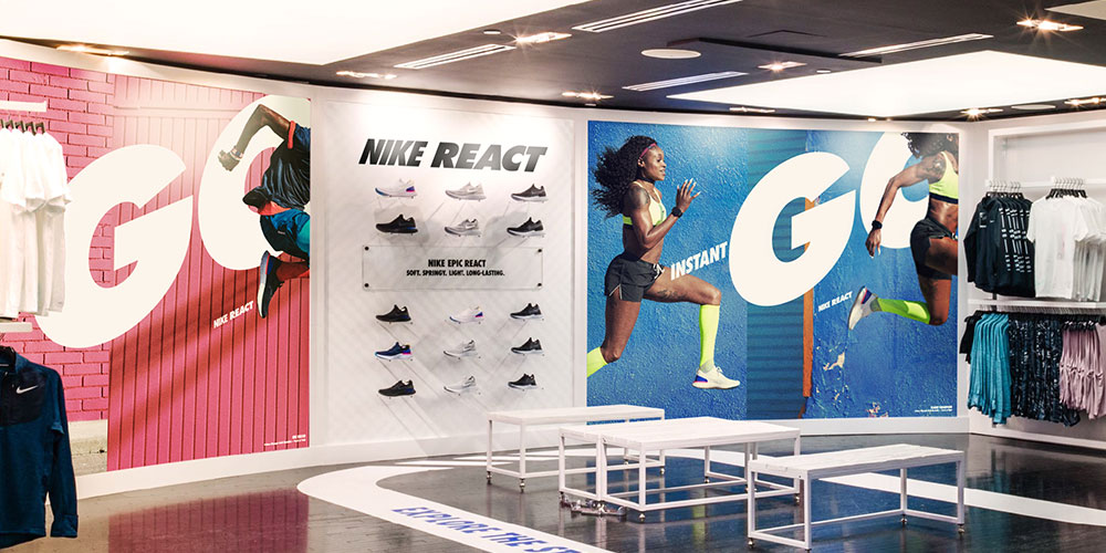 Image of a shoe display flanked by two large graphics and custom floor vinyl as part of a national graphic roll out