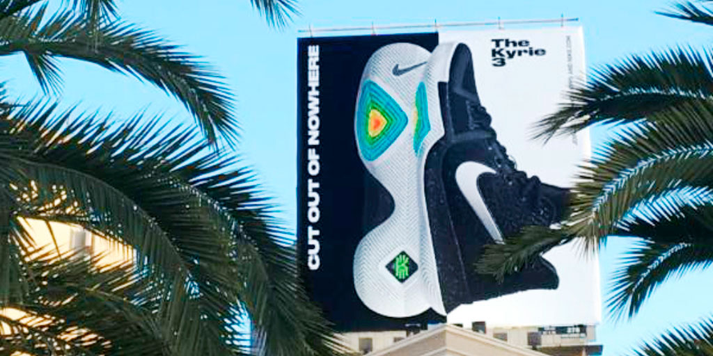 Image of an outdoor billboard featuring a shoe with a colorful sole