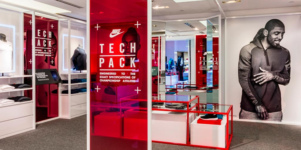 Image of a retail display with wall-sized red acrylic printed graphics